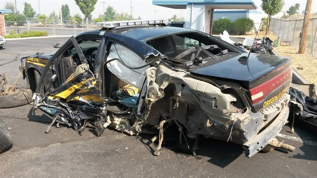 Oregon State Police say a trooper walked away from a crash that destroyed his patrol car. (Photo: OSP)