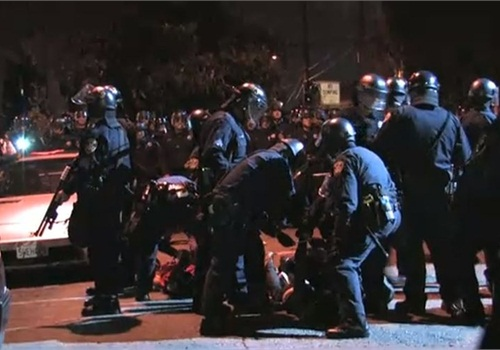Oakland PD officers arrest protesters on Nov. 5, 2010. Screenshot via Youth Radio/YouTube.