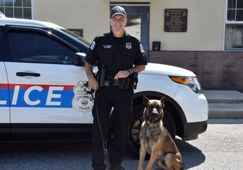 """Officer Brian Carter was training with his K-9 partner Benzi at the Columbus Division of Police K-9 Office"" and was ""correcting Benzi's behavior through verbal commands when the K-9 attacked him."" Image courtesy of Columbus Division of Police / Twitter."
