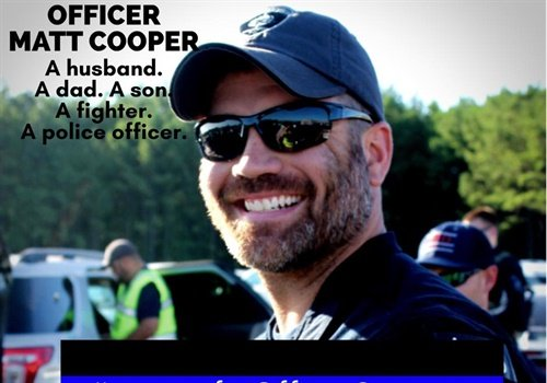 Officer Matt Cooper is listed in serious condition with a bullet lodged at his Carotid artery. Image courtesy of Covington PD / Facebook.