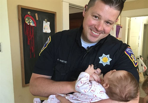 Officer Jesse Whitten had had occasionally encountered the woman while on patrol. During one encounter Whitten's wife was at his side. The two women struck up a conversation, and several months later learned that the homeless woman specifically requested that the Whittens adopt the baby girl. Image courtesy of Santa Rosa Police Department / Facebook.