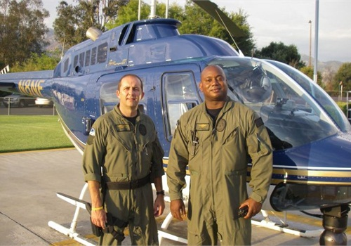 Pasadena PD's Sgt. Mike Ingram and Tactical Flight Officer Brad May with a Bell 206B-3 JetRanger in July 2010. Photo: Paul Clinton