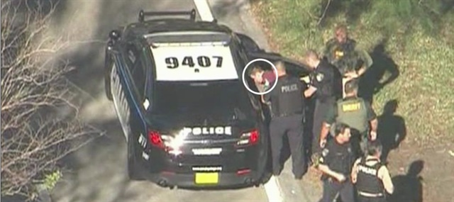 The former student suspected of killing multiple people at a Broward County high school is taken into custody Wednesday. He reportedly escaped the campus by posing as one of his intended victims. (Photo: ABC News screen shot)