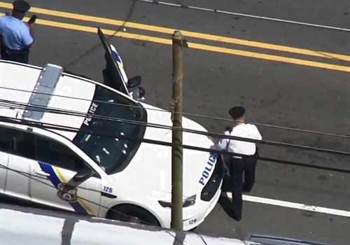 Screen grab of a video posted to Facebook of an ariel view of a Philadelphia car that was riddled with bullets in a running gun battle between a gunman on a bicycle and pursuing police on Thursday morning. Image courtesy of ABC-TV / Facebook.