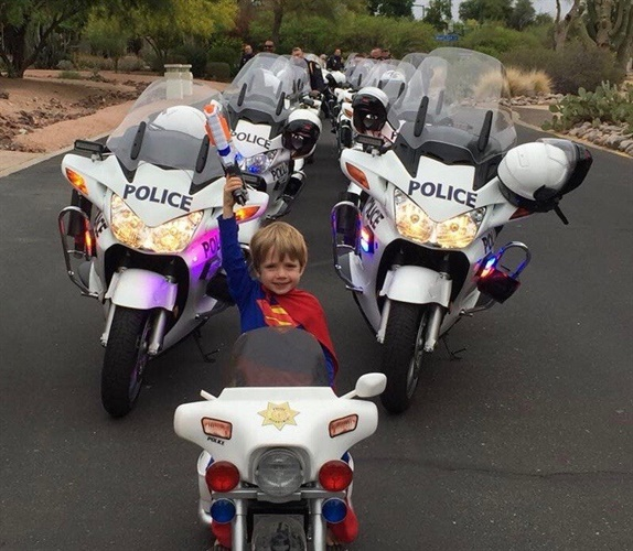 "The Phoenix Police Department took to Facebook to share a photo of one of its young supporters who wanted to join the motorcade for Vice President Mike Pence. The young boy, clad in a Superman costume, posed for a picture on his very own mini ""police motorcycle."" (Photo: Phoenix PD/Facebook)"