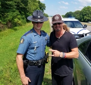 Arkansas State Trooper  Deston Linkous with Brett Michaels, who was in a vehicle traveling east on Interstate 40 on Tuesday and was headed to a concert with Cheap Trick and Pop Evil that night. (Photo: Arkansas State Police)