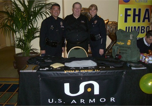 From left to right, Deputy Chief Terry Hara; U.S. Armor's Georg Olsen; and Assistant Chief Sandy Jo MacArthur. Photo: U.S. Armor