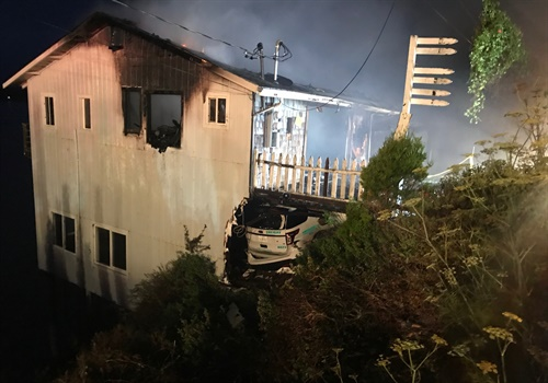 Shortly after the crash, the deputy's vehicle burst into flames and engulfed the house. Photo: Sonoma County Sheriff's Office