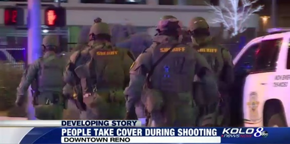 Washoe County Sheriff's deputies outside the Montage Condominiums in downtown Reno. A gunman reportedly took a hostage and fired into the street from the high-rise Tuesday night before he was killed by law enforcement. (Photo: KOLO TV Screen Shot)