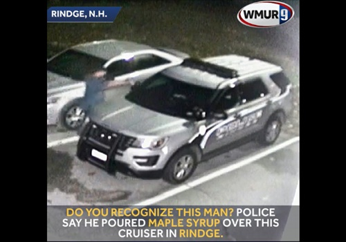 Screen grab of a video of a Rindge (NH) Police Department squad car being vandalized by a man who poured maple syrup all over the vehicle. Image courtesty of WMUR-TV.