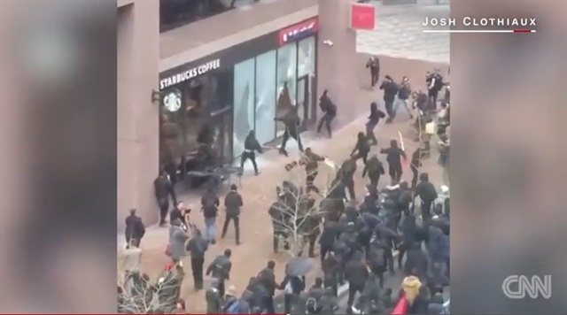 Rioters smash store windows during Trump inauguration protests in Washington, DC. (Photo: Screen shot from CNN video)