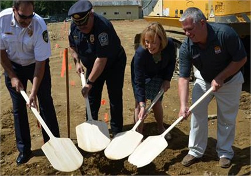 Rustic Crust and American Flatbread frozen pizza CEO Brad Sterl (right) was joined by New Hampshire Governor Maggie Hassan (second from right), New Hampshire Police, Fire & EMS Foundation Founder and President Jim Valiquet (second from left) and Pittsfield (N.H.) Fire Chief Robert Martin (left).