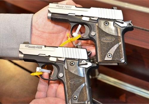 SIG Sauer's P938 (above) and P238 pistols. Photo: Mark W. Clark.