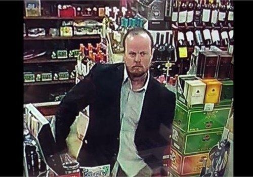 The San Bernardino County (CA) Sheriff's Department released a surveillance photo of the man being sought.