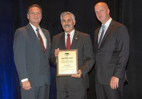 "Scottsdale, AZ, Police Chief Alan G. Rodbell was awarded the ""Egon Bittner Award"" for his significant contributions to the public safety profession and to CALEA. Also in the photo: (Left) Craig Hartley, Executive Director of CALEA, and (Right) Craig Webre, President/Chair of the CALEA Commission and Sheriff of Lafourche Parish, Louisiana. Photo: Scottsdale PD/Facebook"