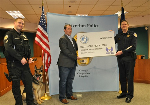 Spirit of Blue presented a $2,500 grant to the Beaverton (OR) Police Department for the acquisition of a new K-9 working dog, sponsored by the Planet Dog Foundation. The grant was presented by Ryan T. Smith of Spirit of Blue (center) and was received by (left to right) Officer Matt Barrington, K-9 Atlas, and Chief Geoff Spalding.