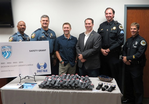 The Dickson County (TN) Sheriff's Office received a grant for 70 tourniquets and duty belt holders from Spirit of Blue. Receiving the grant (left to right) were Chief Deputy Jerone Holt and Sheriff Jeffrey Bledsoe. Presenting the grant (center) was country music star Craig Morgan and Spirit of Blue Executive Director Ryan T. Smith. Representing the grant sponsor, Law Enforcement United, (right to left) were Metropolitan Nashville Police Department Officer Joshua Black and Sergeant Anthony Brooks. (Photo: Spirit of Blue)
