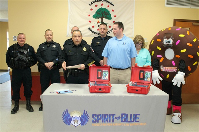 Lanesborough Police Chief Tim Sorrell (front left) makes remarks at the recent grant presentation ceremony where the Spirit of Blue Foundation, represented by Executive Director Ryan T. Smith (front right) presented the department with two Automated External Defibrillators.