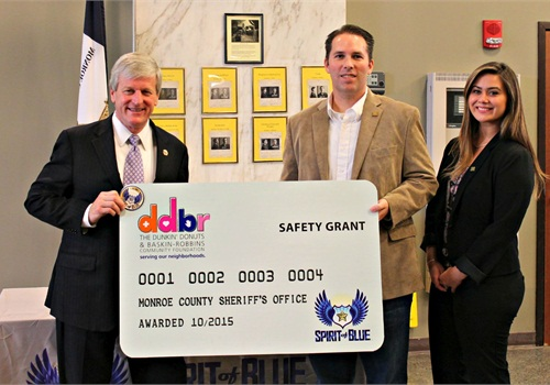 Sheriff Patrick O'Flynn (left) accepted the Safety Equipment Grant at a ceremony held at the Monroe County Sheriff's Office Headquarters in Rochester, NY. Presenting the grant was Ryan T. Smith, Executive Director of the Spirit of Blue Foundation, and Abbey Celeste, Field Marketing Manager from Dunkin' Brands.
