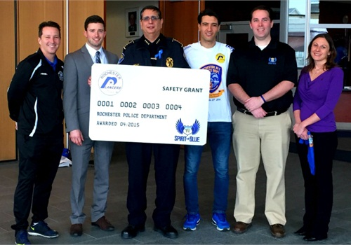 The Spirit of Blue Safety Equipment Grant will provide 8 ballistic vests to the Rochester (N.Y.) Police Department thanks to a generous donation from the Rochester Lancers professional soccer team. Attending the ceremony was (left to right) Doug Miller, Lancers' Head Coach; Rich Randall, Lancers' President; Chief Michael Ciminelli of the Rochester Police Department; Marcello Moreira, Lancers' Goalkeeper; Ryan T. Smith, Executive Director of the Spirit of Blue Foundation; and Amy Pierson, widow of slain officer Daryl Pierson.