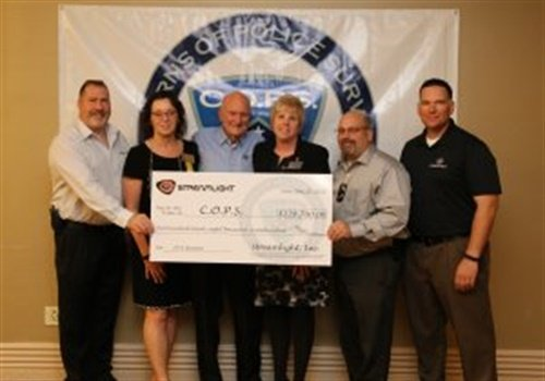 Streamlight employees present a check to representatives of Concerns of Police Survivors, including National President Brenda Donner (second from left) and Dianne Bernhard, the organization's Executive Director. (Photo: Streamlight)