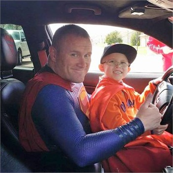 Dallas officer Damon Cole drove 11 hours to play Superman for 7-year-old Bryce Schottel. (Photo: Damon Cole)