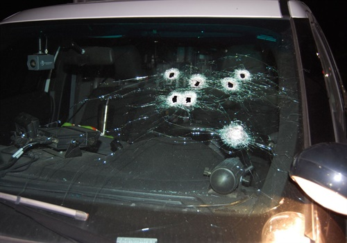 The suspect's shots narrowly missed the officer inside the car. (Photo: Sunset Hills Police Department)
