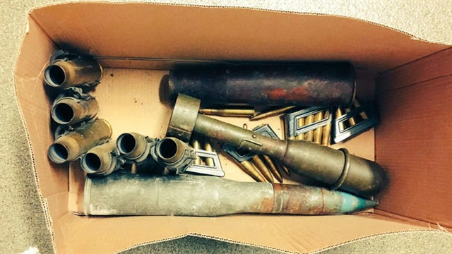 This box of aging military munitions believed to be from World War II was brought to the Dixon (IL) Police Department Tuesday. The department is now asking the public not to bring explosives to the station for disposal. (Photo: Dixon PD)