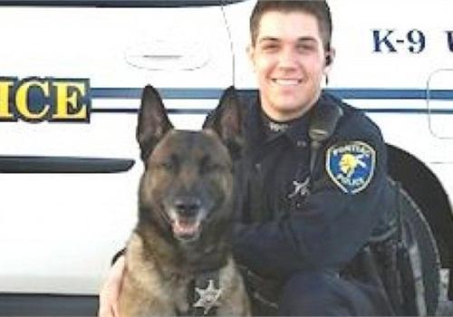 Officer Casey Kohlmeier and Draco (Photo: Pontiac PD)