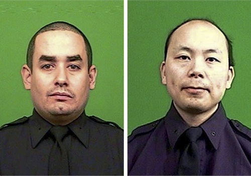 Rafael Ramos, left, and Wenjian Liu were killed while sitting in their patrol car in the Brooklyn on Dec. 20. The shooter reportedly walked up to the passenger side of the car and shot both officers in the head before they had a chance to draw their weapons and respond. He was later reportedly found dead of a self-inflicted gunshot wound in a subway. (Photo: NYPD)