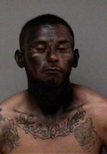 Car theft suspectJose Espinoza spray-painted his face black in an attempt to escape police. (Photo: Madera PD)