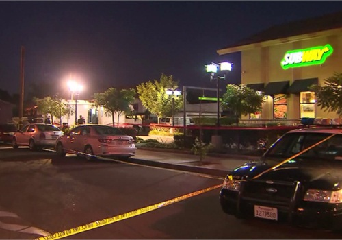 The scene outside the Subway where an officer shot a suspect holding two female employees at knifepoint. (Photo: KTLA screen shot)