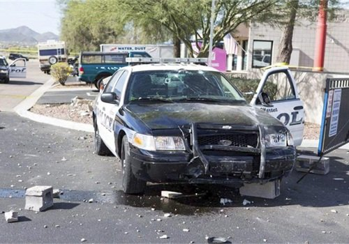 Rapiejko's patrol car after the incident. Rapiejko was not injured. The suspect was hospitalized for two days then booked into jail on multiple felonies. (Photo: Marana PD)