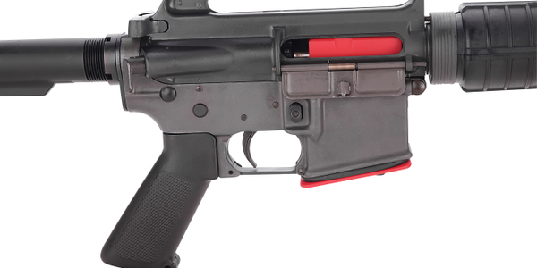 The lock secures both the upper and lower receivers.