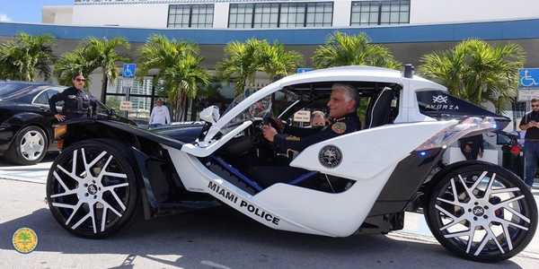Miami PD's new three-wheel Polaris Slingshot was donated by the company to be used as a...