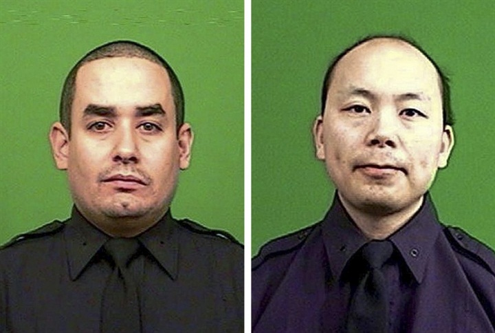 Families of Slain NYPD Officers Ramos and Liu Throw Out First Pitch at Mets Game