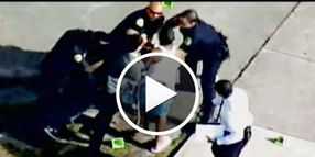 Video: Victim's Family Fights with Cops at Crime Scene