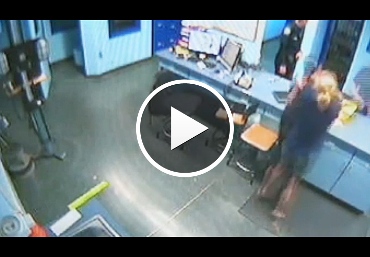 Video: Fla. Woman Chokes Officer at Station After Arrest