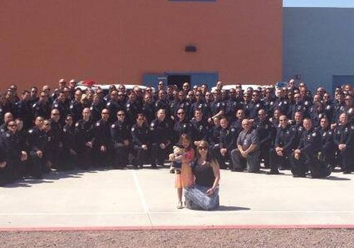 100 Officers Attend Fallen Cop's Daughter's Graduation