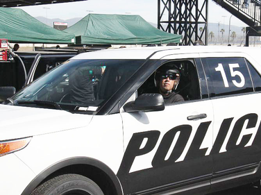 An LASD deputy rolls the Ford P.I. Utility EcoBoost toward the road course for testing.