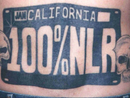 This license plate tattoo with a pair of skulls identifies a Nazi Low Rider member. The NLR...