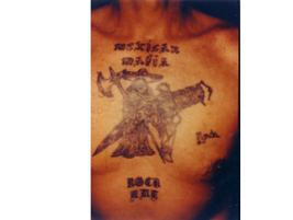 This Mexican Mafia tattoo depicts a Mexican Grim Reaper image. It is a memorial for Rocky Luna,...