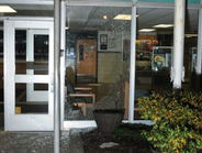 Bullets shattered this glass floor-to-ceiling window.