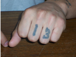 The 13 on this gang members fingers shows that he is a Sureño aligned with the Mexican Mafia. He...