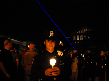 Officer with candle.