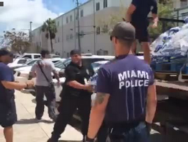 Miami officers deliver bottled water to fellow first responders in Key West. The water was paid...