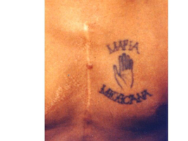 "Another Mexican Mafia tattoo with an open hand referencing the ""black hand of death."" The scars..."