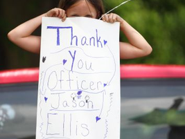 A local resident thanks Officer Ellis for his service.