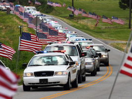 A procesion of some 800 vehicles heads toward High View Cemetery in Chaplin.
