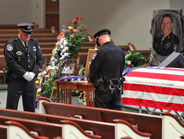 Officers with heads bowed prepare for the start of the memorial service.